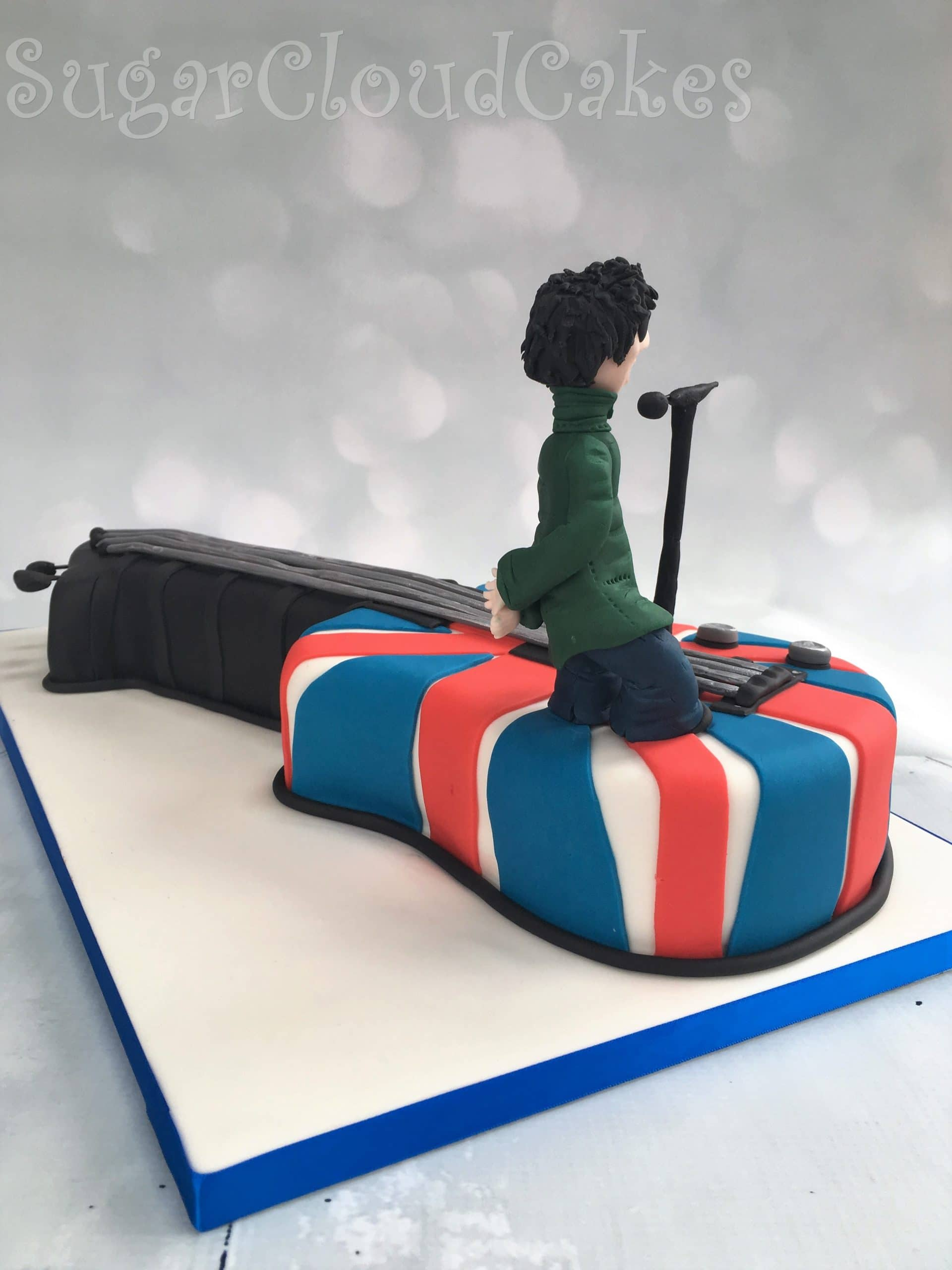 Liam Gallagher guitar shaped birthday cake