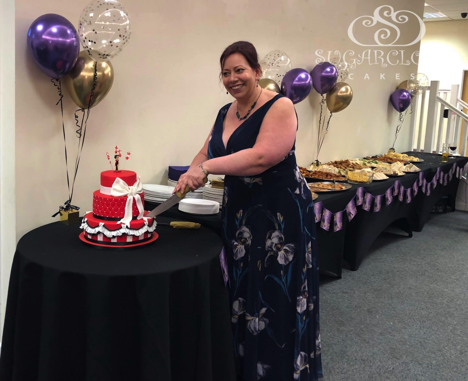 Jo cutting her cake